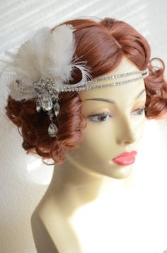 Double layer rhinestone band with detachable fascinator. Ivory and light ivory feathers. One of a Kind