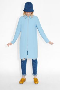 Hello there baby sky blue, we've been thinking about you! A fully lined '60's-esk coat that is rockin' a simple, long line form in a crêpe like texture. Collared with pockets at the sides.  colour: your sky's blue  In a size small the chest width is 97 cm and the length is 94 cm. The model is 167 cm and is wearing a size small.