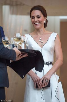 Cheers to that! After an action-packed first day in Warsaw that included a visit to the presidential palace, a start-up business event and meeting crowds of adoring fans, the Duchess savoured the chance to enjoy a sip of white wine