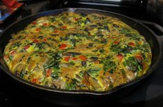 Veggie Frittatta   A wonderful way to save money on your grocery bill is to have breakfast for dinner from time to time.  Frittatas are a quick and easy cross between an omelet and a crustless quiche.  This frittata is loaded with veggies too!  Serves 3-4.