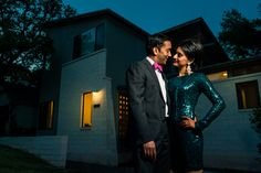 Indian Couple in stunning green sequin dress and tux with pink bow tie. Standing in front of modern architecture.  See more of our work at www.azulox.com