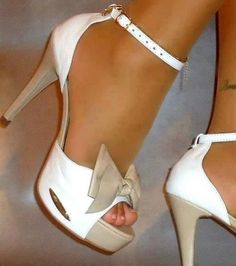 Tan and white heels. Love the bow.