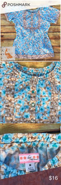 """Koi by Kathy Peterson scrub top Koi by Kathy Peterson scrub top blue beige flower print size medium   Cute blue beige floral print scrub top cute buttons  Ruched neckline   Used but like new in great condition   All measurements taken with garment laying flat   Shoulder to shoulder –16""""   Under arm to under arm –19""""   Length –25""""    Any questions please feel free to ask Koi By Katy Peterson Other"""