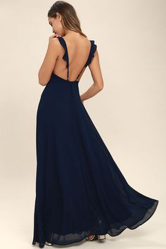 Your allure will be at an all-time high when you slip into the Meteoric Rise Navy Blue Maxi Dress! Breezy woven fabric sweeps over a princess seamed, triangle bodice with ruffled, adjustable straps. An open back and covered buttons adds an elegant touch, while a full maxi skirt sways below.