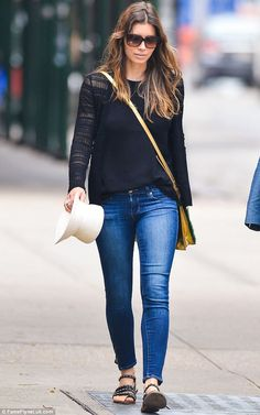 A different look: Jessica then changed and was later spotted in a simple black top, jeans and sandals
