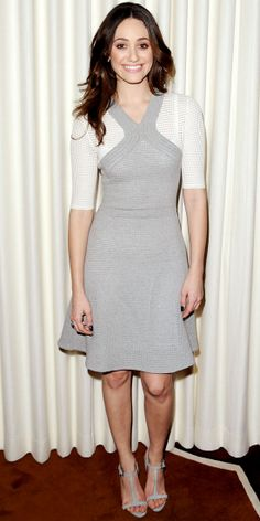 Rossum greeted fans at a press event for Beautiful Creatures in a knit dress and gray T-straps.