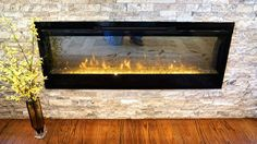 Recessed electric fireplace in stone wall