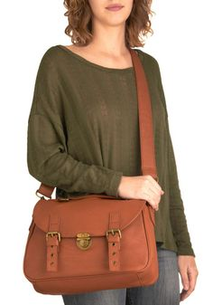 Vegan faux leather. pretty lining. perfect amount of space for all the stuff I carry :) @ModCloth