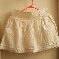White Swiss dot miniskirt Rosebud detail on hem, pockets, thick elastic waistband Charlotte Russe Skirts Mini
