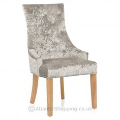 Stunning crushed mink velvet and charming oak finished legs make the Ascot Oak Dining Chair Mink Velvet an elegant choice.