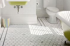 Add a luxurious feel underfoot with mesh-backed marble tile featuring impressive 3-inch hexagons.  Similar to shown: Carrara White Hexagon Mosaic Tile, about $10 for a 0.92-square-foot sheet; Marble Online