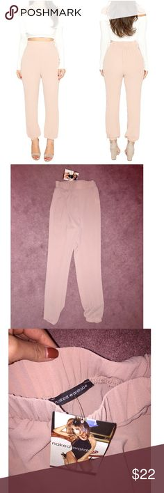 Naked Wardrobe Joggers Naked Wardrobe Joggers, never worn tags still on! Light pink/cream colored, scrunched at the ankle. Naked Wardrobe Pants Track Pants & Joggers