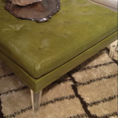 Green leather ottoman with lucite legs by Lee Industries.