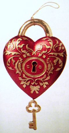 red heart shape with a key hole in the middle of the heart lock - and a tiny gold key dangles off the bottle of the heart