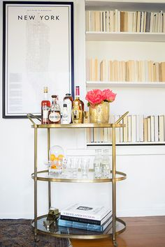 gold bar cart + simple wall shelf