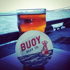 Buoy Beer Company, Astoria, Oregon — by The Broad Abroad. Incredible micro-brewery with great food and drinks! Part of the restaurant floor has a glass bottom to view sea...