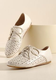 <p>There's no need to keep all the enthusiasm you have for these ivory Oxfords all to yourself! The ModCloth-exclusive silhouette, micro wedges, and pretty perforations of these vegan faux-leather flats are all elements worth gushing over - and details that'll have your fashion following listening closely.</p>