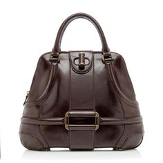 A classic Alexander McQueen satchel in polished brown leather with antique gold-tone hardware. Details include two rolled handles, a belted turnlock, zip closure, and fully lined interior with one zip pocket.