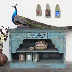 Restored Teak Cabinet/ Side Board, recycled teak mirrors and iron vase all from India. Ocean ceramics from Northern Thailand and a NZ peacock. Support ethical and sustainable trade. Rustic Furniture, Vintage Furniture, Side Board, Northern Thailand, Indoor Outdoor Living, Interior And Exterior, Teak, Peacock, Mirrors