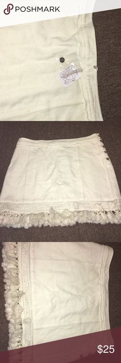 """NWT Free People Skirt Absolutely beautiful staple garment, a must have! Gorgeous cream color skirt. Please take the time to look at all the pictures, this skirt has been hanging in my closet because it don't fit me😞 I had it next to a red color jacket and some of it rubbed off to my skirt 😳 I truly think that if I wash it or took it to a dry cleaner it will come off; it still has the tags on and I'm not going to wear it and for that reason I want to sale it """"AS IS"""", also it will be price…"""