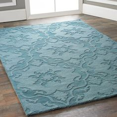 Damask Imprints One Color Rug. Turquoise. Could work in bedroom