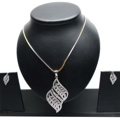 Fascinating Silver & Gold Pendant Set Item code : JVI292 https://twitter.com/bharatplaza_in https://www.facebook.com/bharatplazaindianbridal