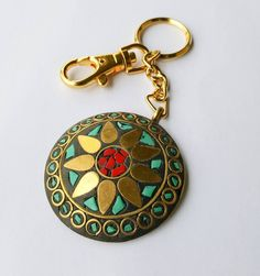 Check out this item in my Etsy shop https://www.etsy.com/au/listing/459777076/mandala-keychain-turquoise-and-red-coral