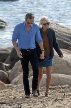 So happy: Taylor couldn't wipe the smile off her face as she walked hand in hand with Tom ...