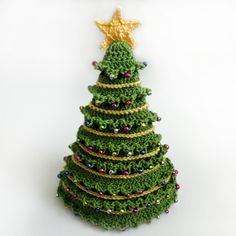 Crochet Spot- Christmas Tree Hat $$ Crochet pattern. I would instead crochet a round bottom and stuff using thread and use it in my Christmas village
