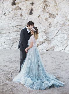 blue wedding dress skirt - photo by Ashley dePencier Photography http://ruffledblog.com/dusty-blue-beach-wedding-inspiration