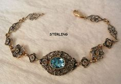 Always something exciting in store many items on sale from 10 to 60% off Beautiful Deco style Sterling Blue topaz color and rhinestone Link Bracelet
