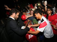 @manutd no.8 Juan Mata signs autographs for  fans during the club's 2014 pre-season tour of the USA.
