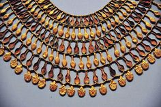 Broad collar of Nefer Amulets. Period: New Kingdom. Dynasty: Dynasty 18. Date: ca. 1504–1450 B.C. Geography: Country of Origin Egypt, Upper Egypt; Thebes, Wadi Gabbanat el-Qurud, Tomb of the 3 Foreign Wives of Thutmose III, Wadi D, Tomb 1. Medium: Gold, crizzled glass, Egyptian blue.