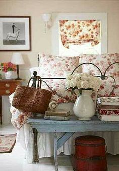 Love this idea of a farm bench or small table at the end of the bed.