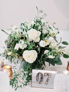 Organic classic wedding table centerpieces: http://www.stylemepretty.com/2016/11/30/the-stave-room-wedding-at-american-spirit-works/ Photography: Amy Arrington - http://www.amyarrington.com/