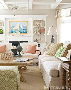 Pale green walls and sandy-hued furnishings articulate this home's coastal surroundings - Traditional Home® / Photo: John Bessler / Design: Mary O'Brien Cabaron