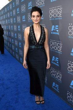 Pin for Later: 17 Unforgettable Looks From the 2015 Critics' Choice Awards Jenny Slate Jenny dared to bare skin in a black Miu Miu dress with a plunging neckline.