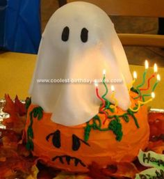Homemade Ghost and Pumpkin Cake... This website is the Pinterest of Halloween cakes