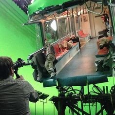 Godzilla Set Photo Reveals a Destroyed Subway Car -- Director Gareth Edwards is seen setting up a green screen action scene in this latest behind-the-scenes look at the Legendary Pictures thriller. -- http://wtch.it/MamtY