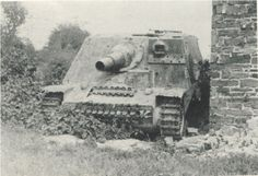 A abandoned Brummbar assualt gun with an interesting field modification of an added machine gun ball turret and armor plate section added to the front upper corner