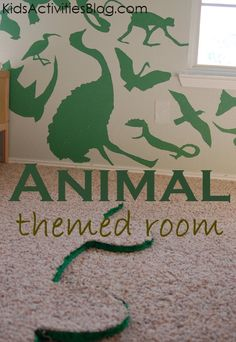 It's an animal themed boys bedroom.  I love the vector-like collage of animals on the wall!  #decor #kids #home