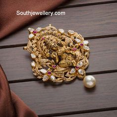 Jewelry OFF! 22 carat gold antique finish Goddess Lakshmi pendant studded with flat diamonds diamonds rubies and south sea pearl drop. Gold Wedding Jewelry, Gold Jewelry Simple, Gold Jewellery, India Jewelry, Bridal Jewelry, Silver Jewelry, Gold Pendent, Diamond Pendant, Gold Earrings Designs