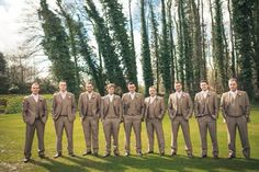 I love the brown suits! It'll go with any of the bridesmaids dresses colors...light pink, light olive green, champagne, and light brown
