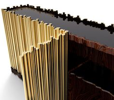 An unique exclusive and contemporary sideboard - Symphony by Boca do Lobo | Cabinet made from wood finished covered by a tubular structure in gold plated brass. | For more details visit http://www.bocadolobo.com/en/limited-edition/sideboards/symphony/