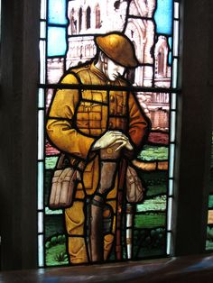 https://flic.kr/p/aFYm4e | Nottingham High Pavement S-Transept War Memorial Detail Pitcher & Piano IMG_1566 adj | A detail of the Soldier in front of the Ruins of Ypres from the centre of the 1920 War Memorial Window by Clayton & Bell. The adjacent light has a sailor at Mons.  The tracery gives devices of local Notts, Derby and Leicester regiments and some battles eg Talavera   To the Glory of Go