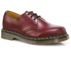 Doc Marten 1461. A twist on the iconic Doc Marten boot for a more unique look without compromising durability and comfort. The smooth finish and classic leather looks great in a 'Cherry Red' color.