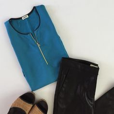 L'AGENCE NWOT sleeveless blouse with leather trim Blue L'Agence blouse with leather trim around neck and arm holes. Has a silver zipper down the front. NWOT never worn. L'AGENCE Tops Blouses