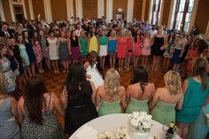 I am an alumna from the Epsilon Zeta chapter (pledge class 2009). This is a picture from my wedding in July of 2013. It is our tradition to circle around the bride and groom and sing the Alpha Gam guy song. It was so awesome to have so many sisters at my wedding!