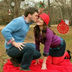 Love, romance, Christmas pictures, couples pictures, purple, red, blue, kiss, mistletoe, holiday, www.highheelstosneakers.com