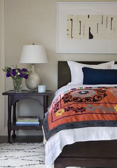 Bedroom by Caroline Edwards -- digging the colors, the artwork and the cushy rug.